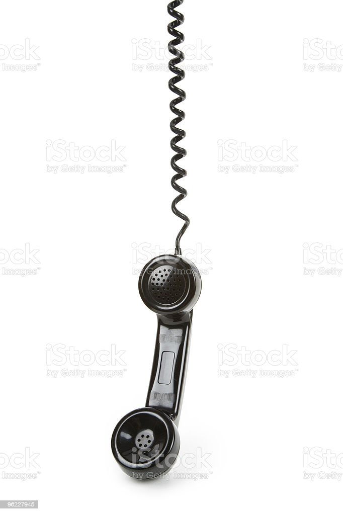Black corded telephone on a plain white background stock photo