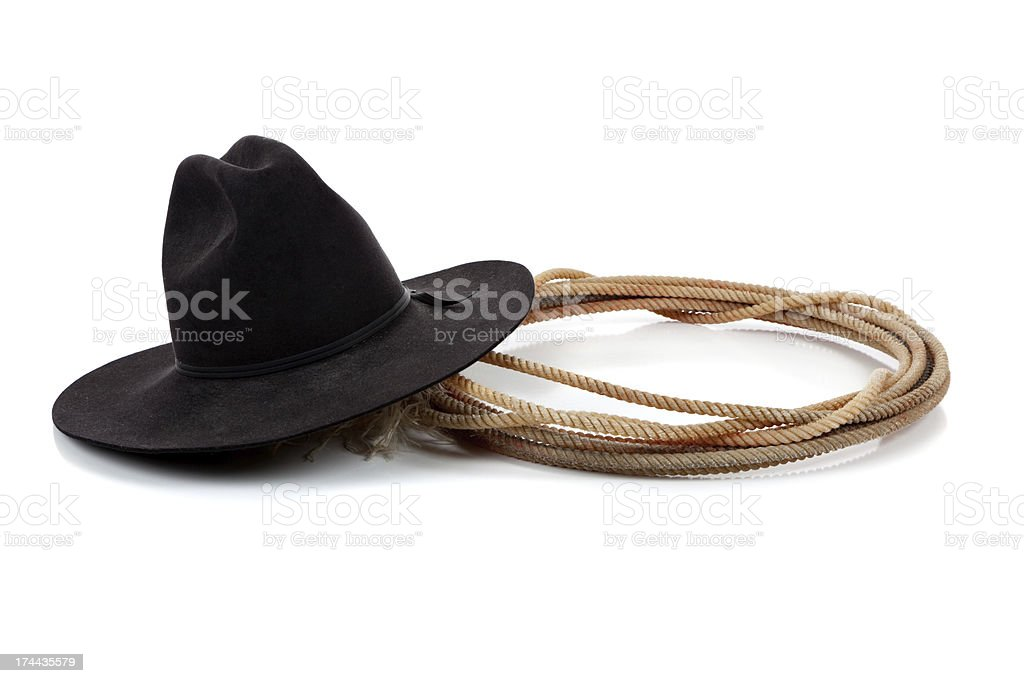 Black cowboy hat and lasso on white stock photo