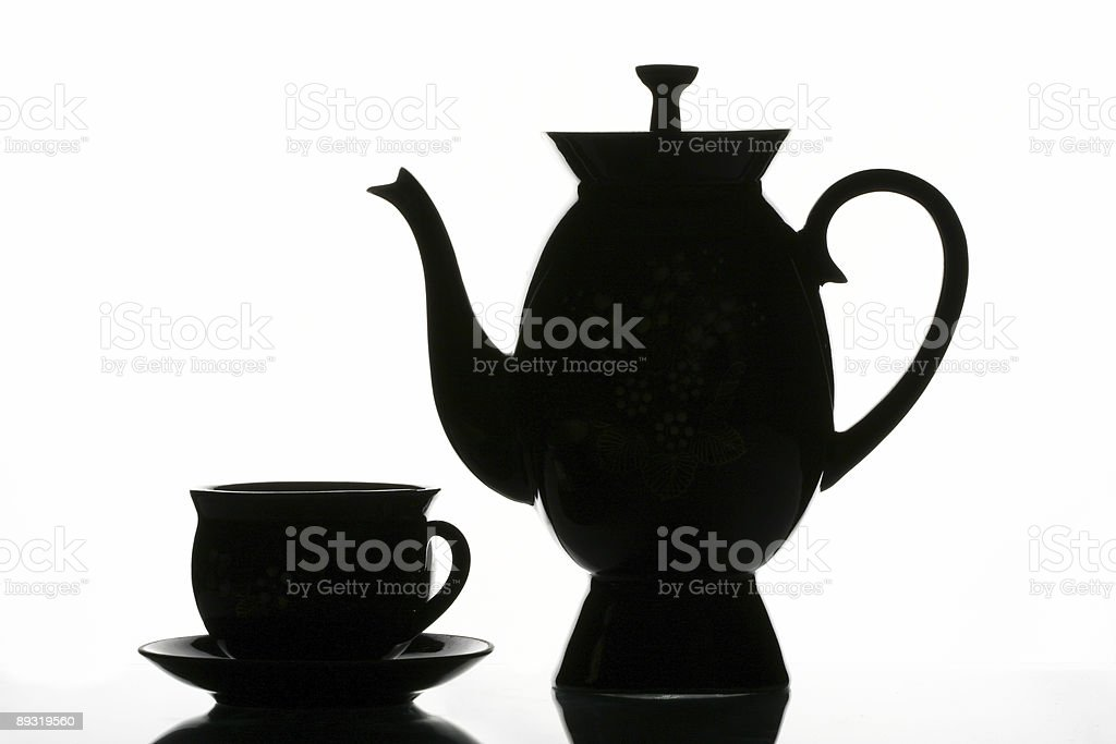 Black cup and teapot royalty-free stock photo