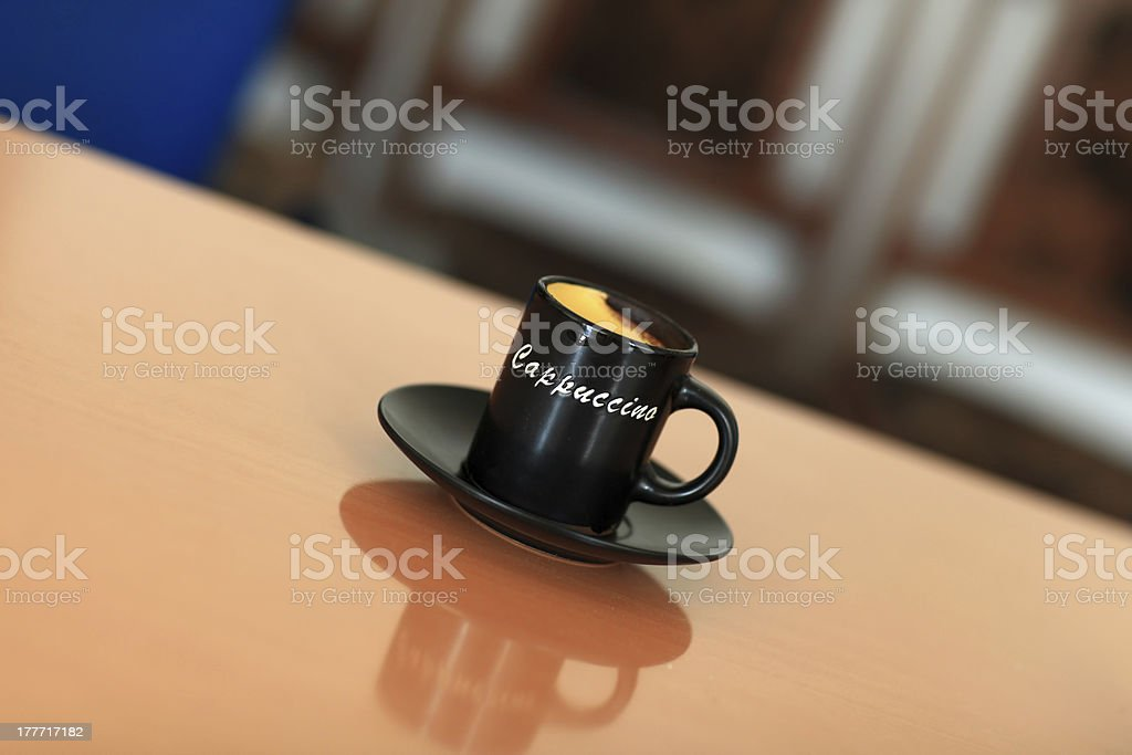 Black cup of cappuccino royalty-free stock photo