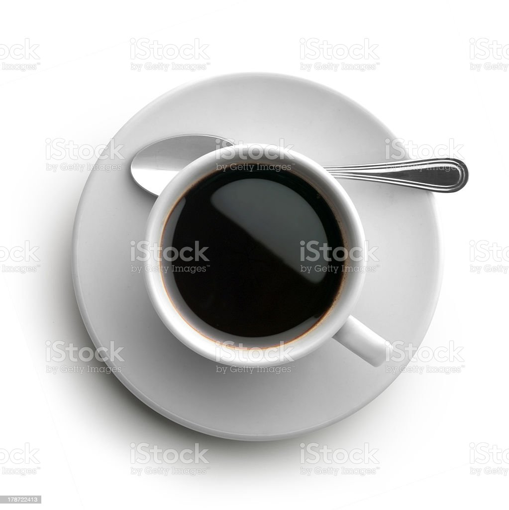 A black cup of coffee with a spoon on the side of the plate stock photo