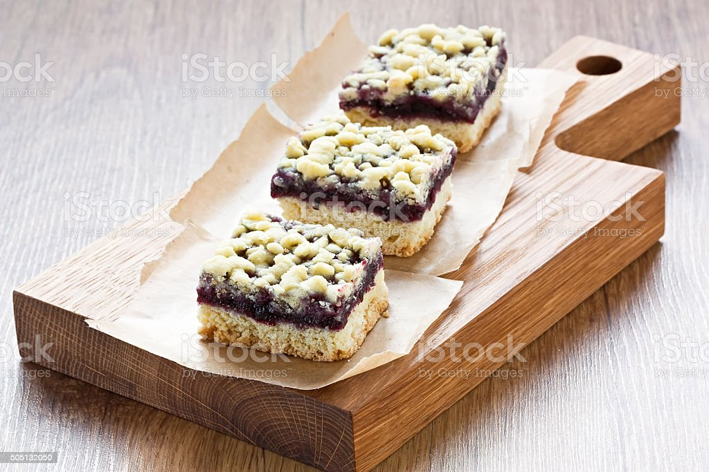 Black currant crumble pie bars stock photo