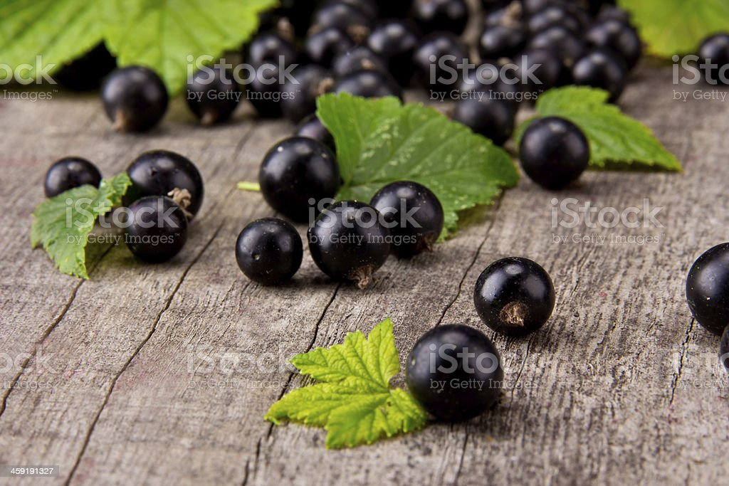 Black currant upon a wooden table stock photo