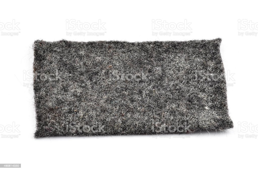 Black cut out textile patch on white background tilt viewpoint stock photo