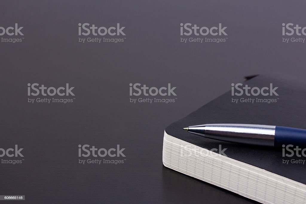 Black daily planner with luxury ball pen stock photo