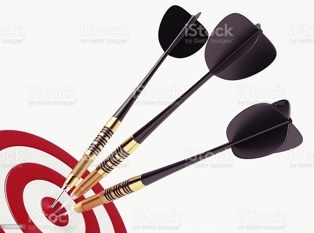 Black darts on bullseye of red target royalty-free stock photo