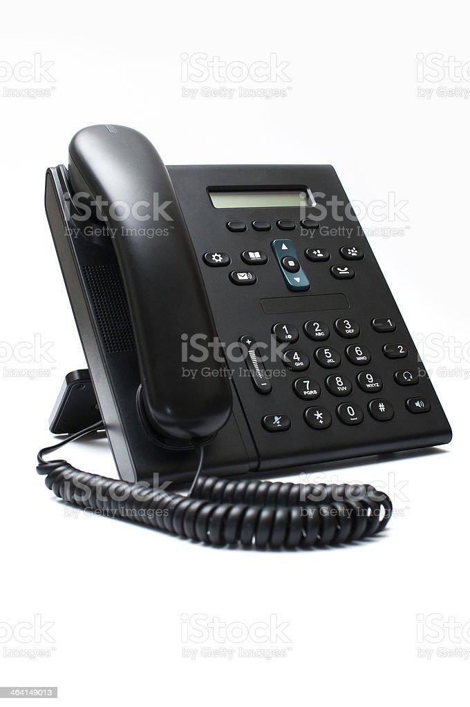 Black deskphone on a white background stock photo