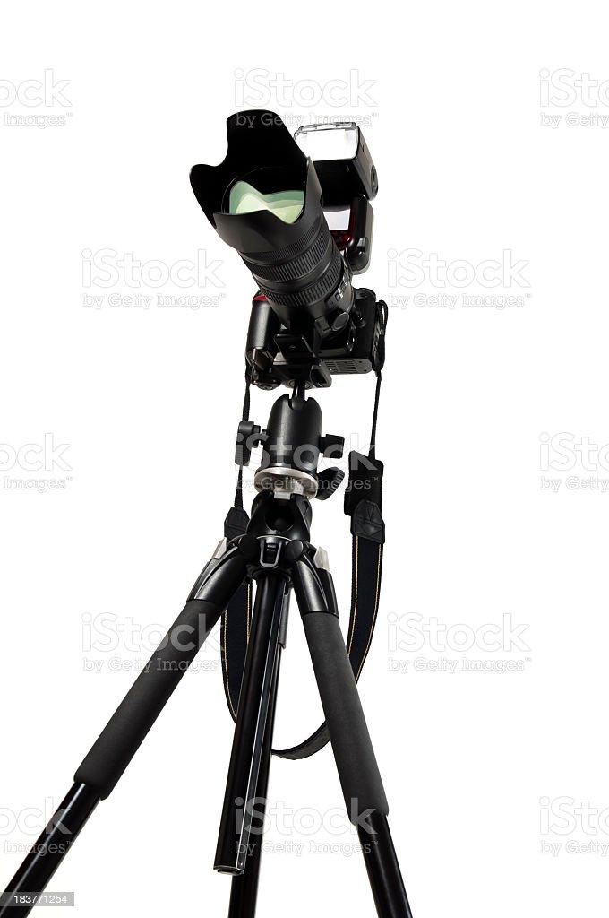Black digital camera on tripod isolated royalty-free stock photo