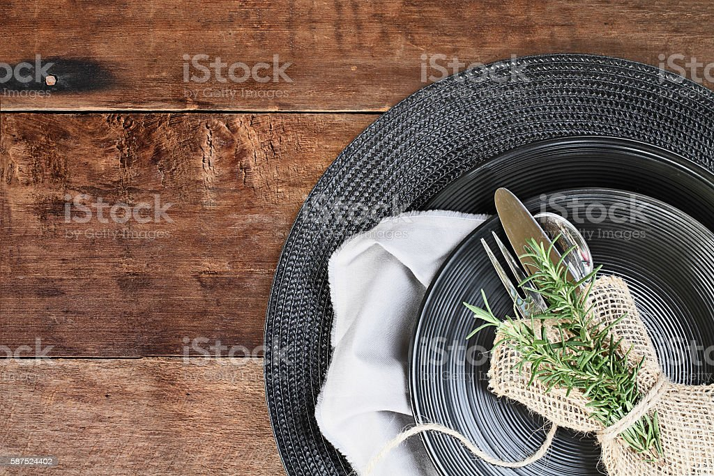 Black Dinnerware over Wooden Background stock photo