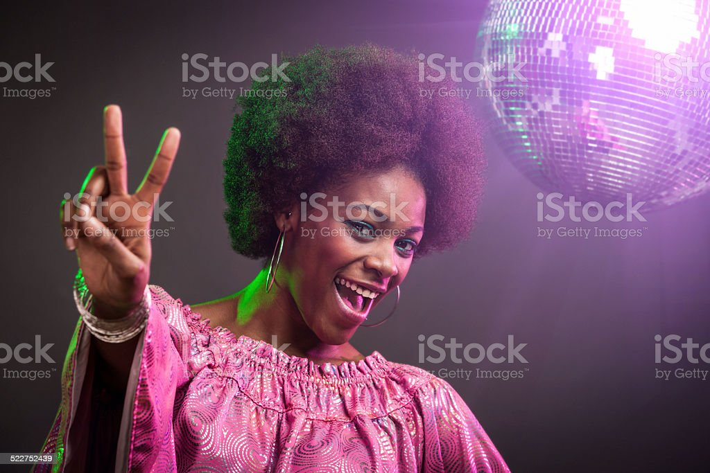 Black Disco Dancer Woman Peace Sign stock photo