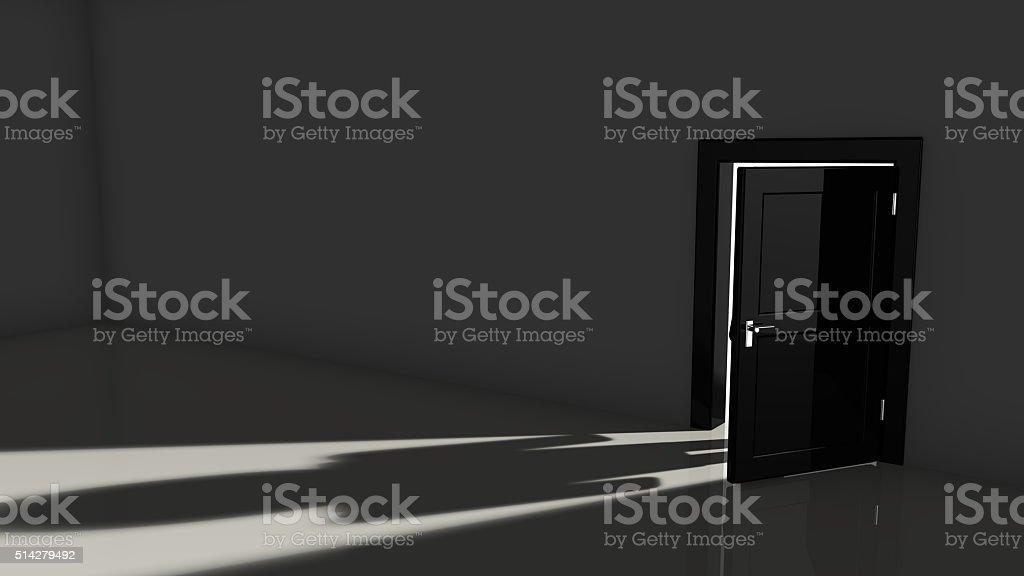Black door opening in a dark room stock photo