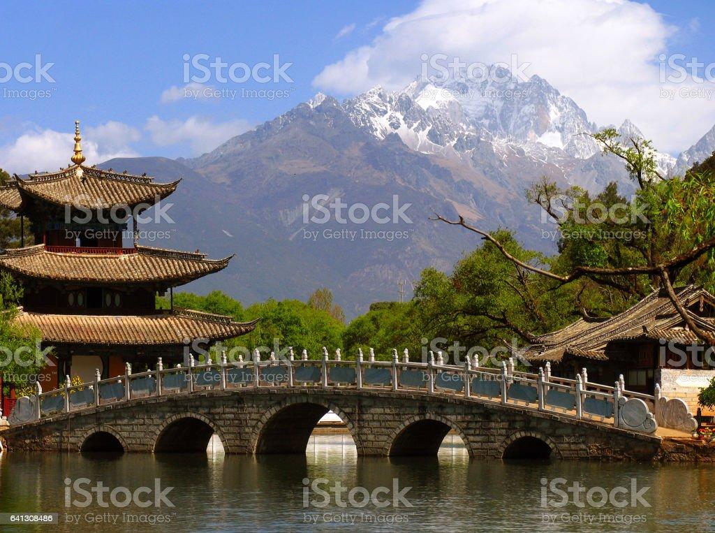 Black Dragon Pool and Jade Dragon Snow mountain (Yulongxui Shan) in Lijiang, Yunnan province of China stock photo