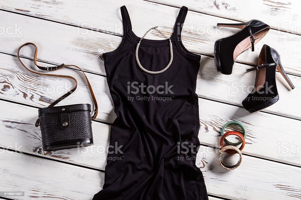 Black dress and small necklace. stock photo