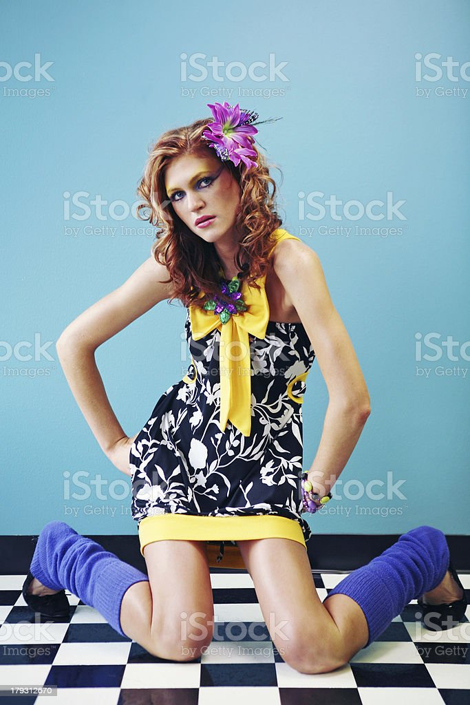 Black Dress Girl on Checkered Floor and Blue Wall royalty-free stock photo