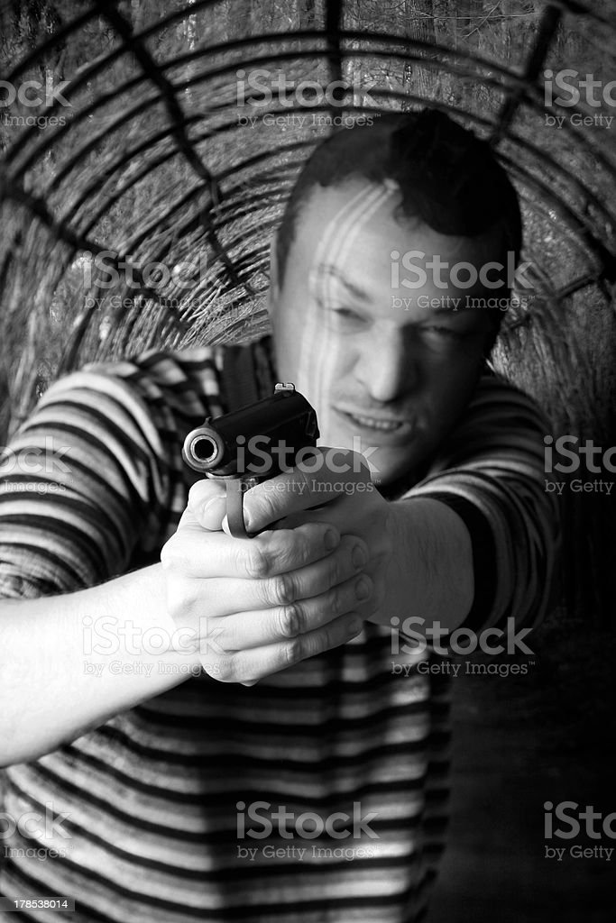 Black dressed man with gun royalty-free stock photo