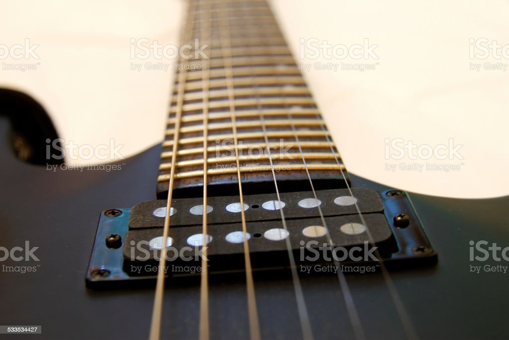 Black electric guitar isolated on the white backgriund stock photo