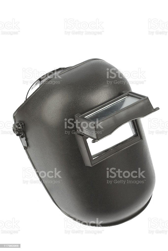 Black electric welder a mask with eye slot open stock photo