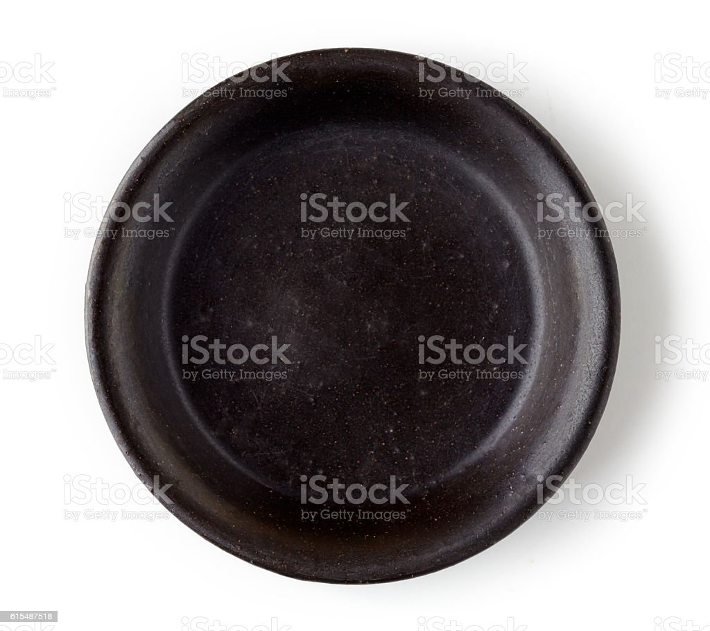 Black empty bowl isolated on white, from above stock photo