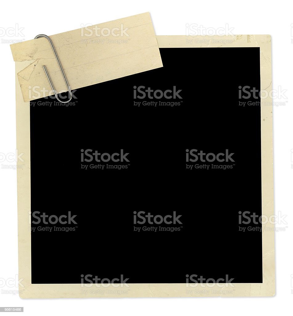 Black empty old photo frame with a paper clip stock photo