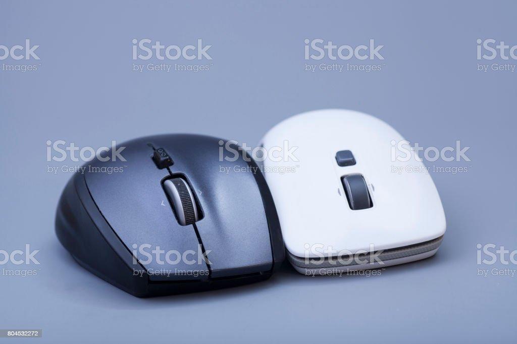 Black end white wireless computer mouses on gray stock photo