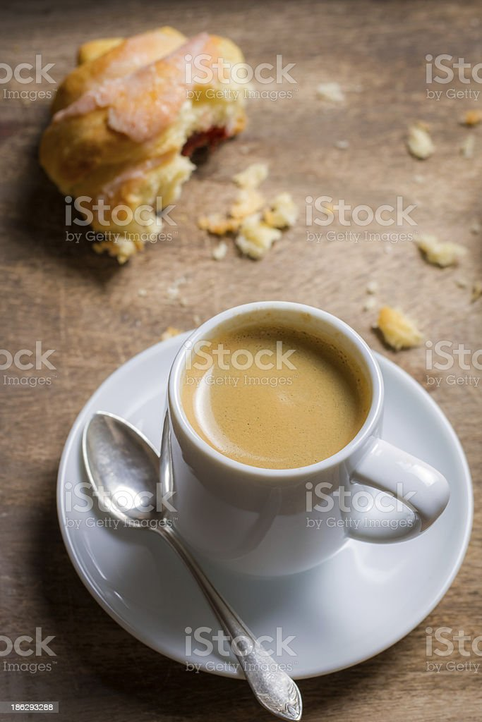Black espresso and a fresh croissant royalty-free stock photo