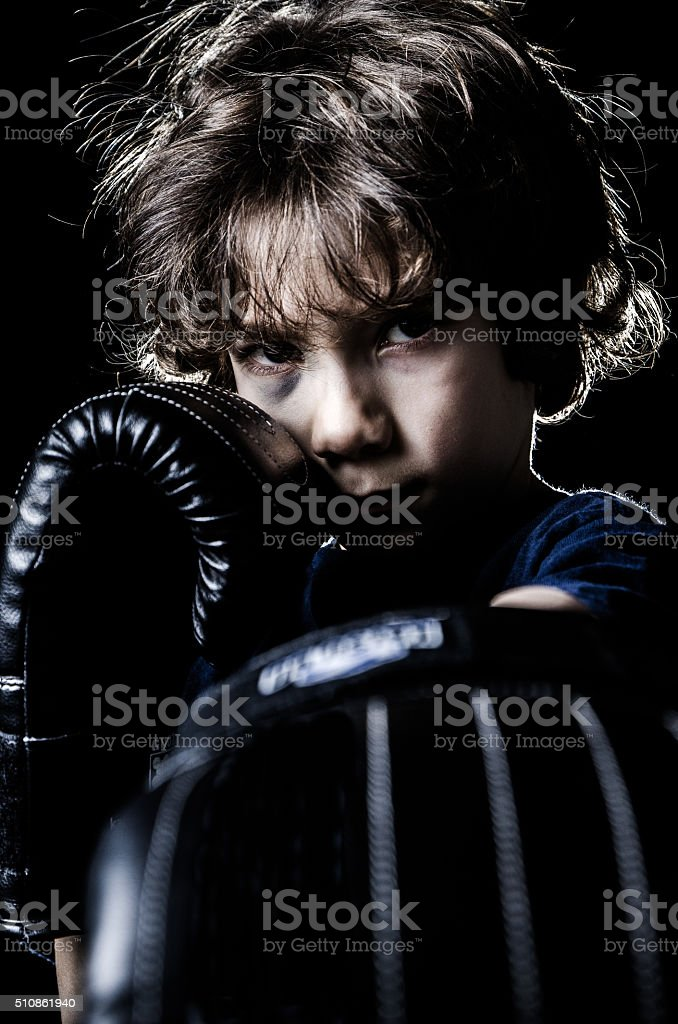 Black eye boxer kid boy stock photo