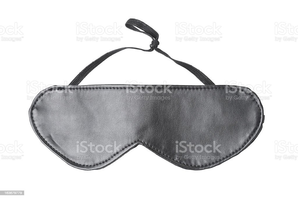 Black eye mask made of leather on a white background stock photo