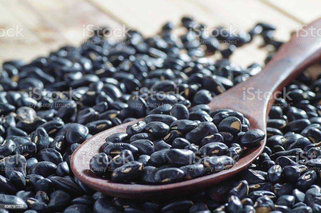 black Eyed Peas on wood spoon on wood background stock photo