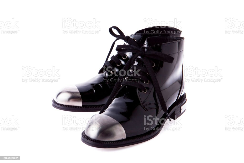 Black fashion boot with metal head on background stock photo