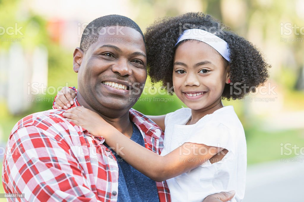 Black father with mixed race daughter stock photo