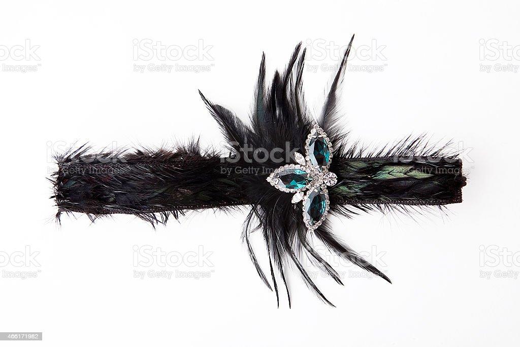 Black feather headband with jewelry stock photo