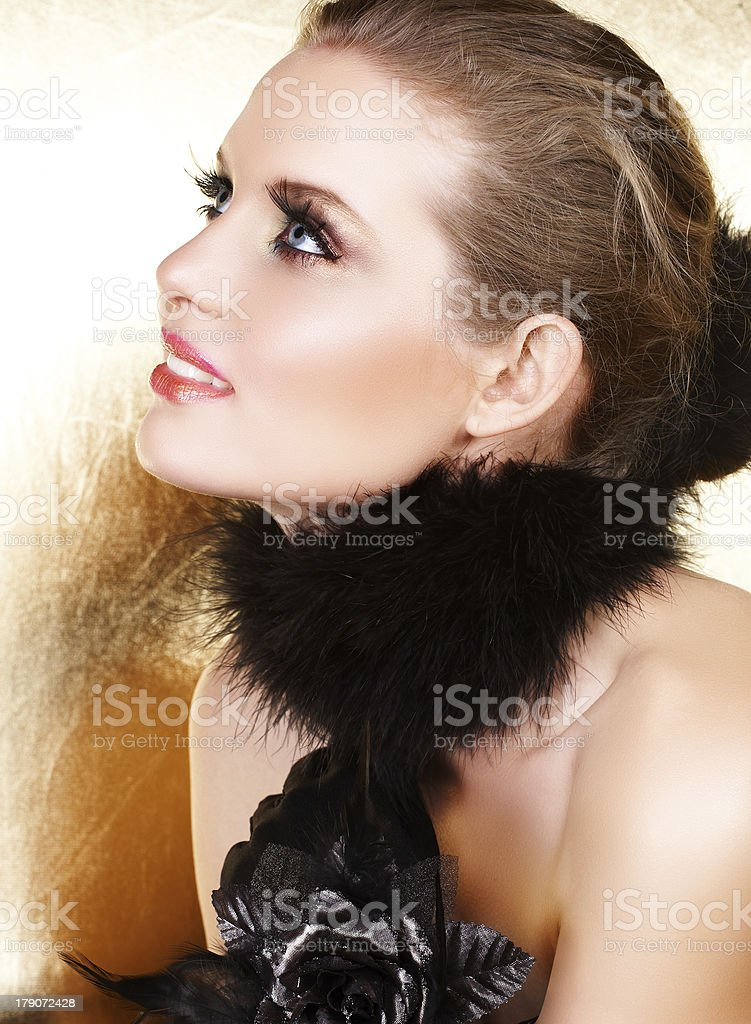 Black feathers and blond woman royalty-free stock photo