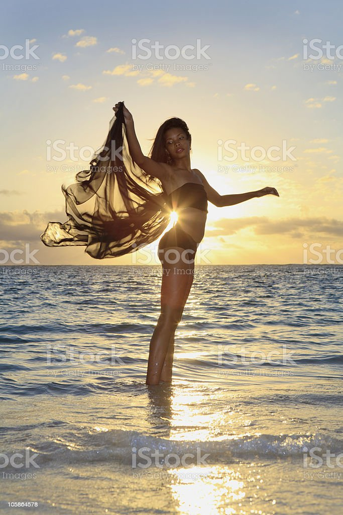 black female dancer standing in the ocean royalty-free stock photo