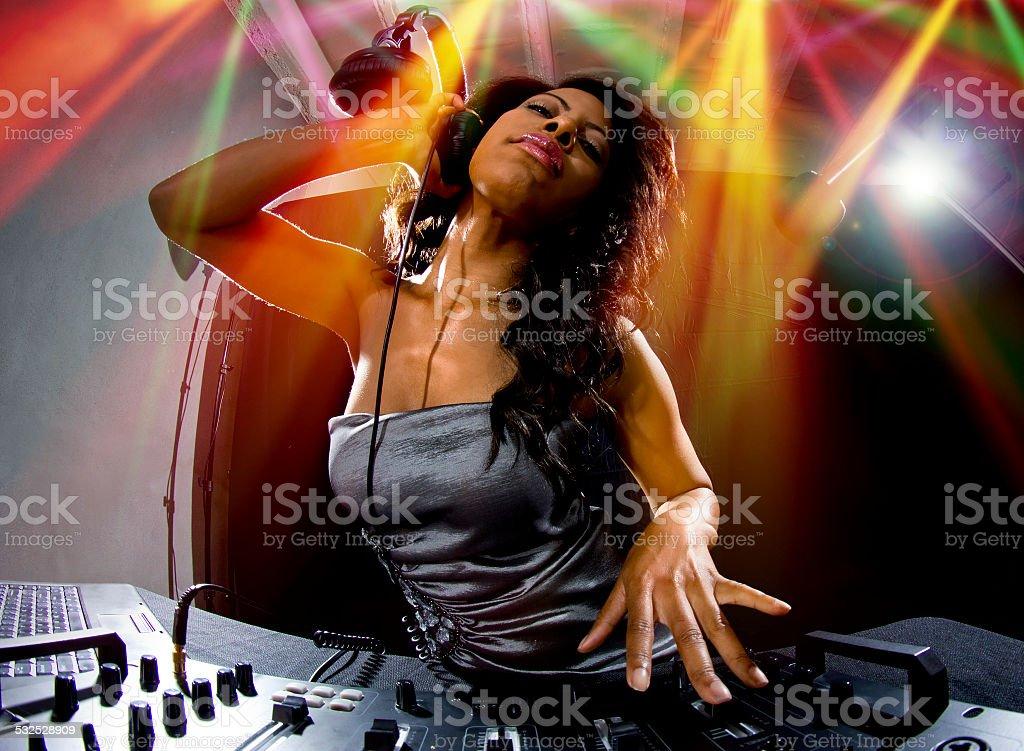 Black Female DJ in a Nighclub Party Playing Music stock photo