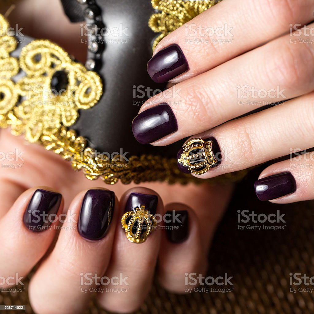 Black female manicure nails closeup with crown stock photo