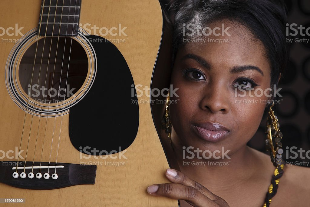 Black Female Musician Holds Her Guitar Closeup royalty-free stock photo