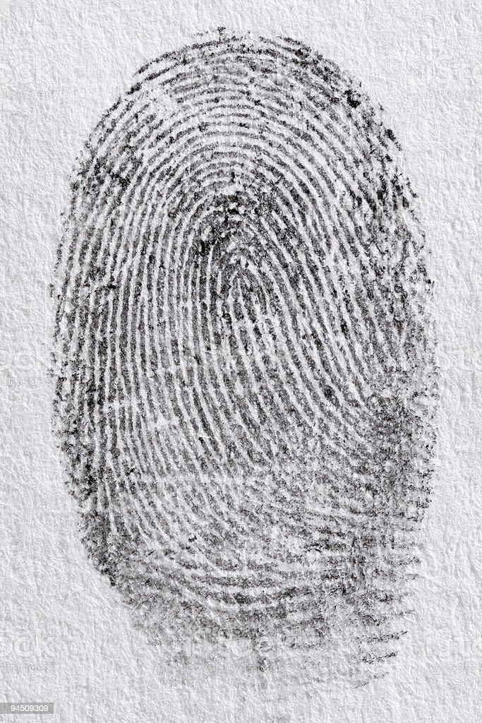 Black fingerprint on white paper stock photo