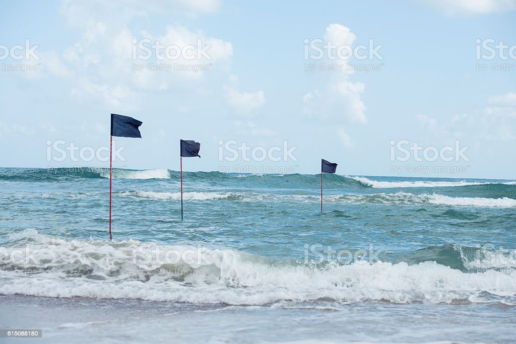 Black flags - water is closed to public use. stock photo