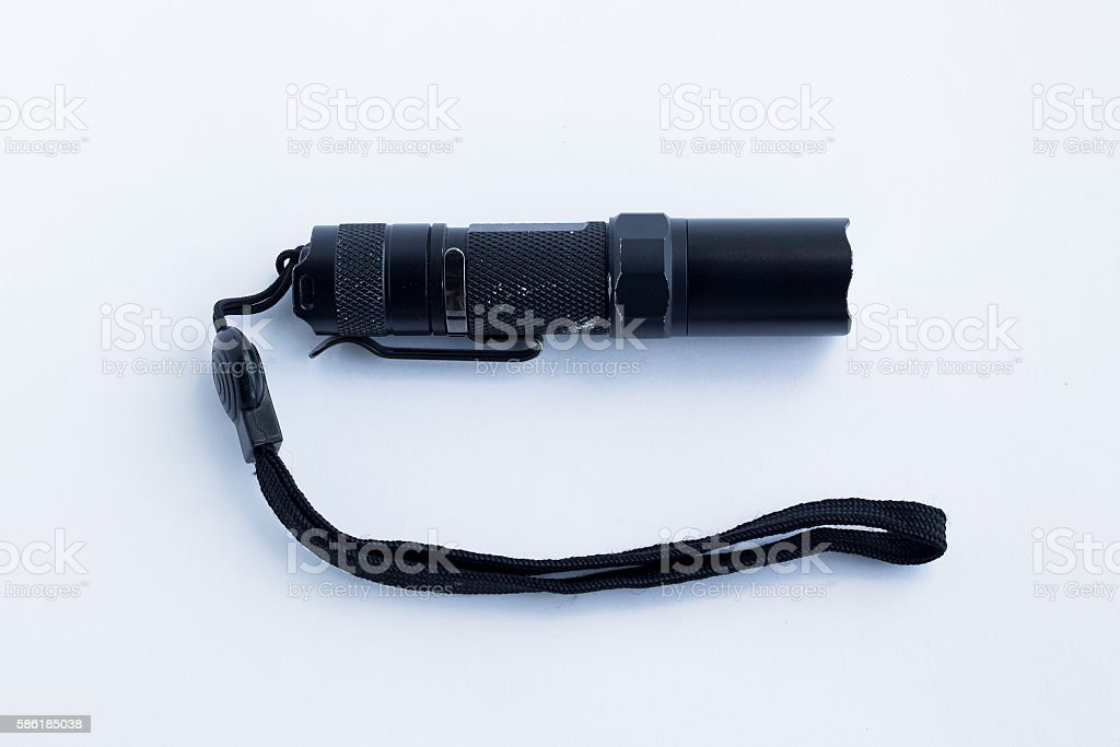 Black flashlight on a white background stock photo