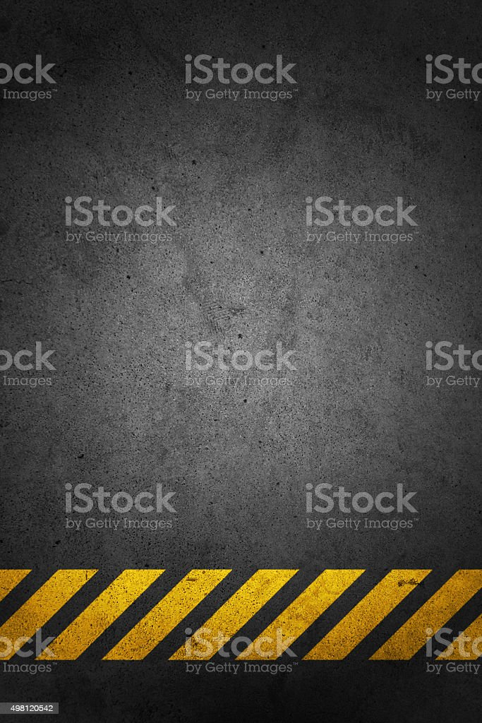 Black floor with yellow stripes stock photo