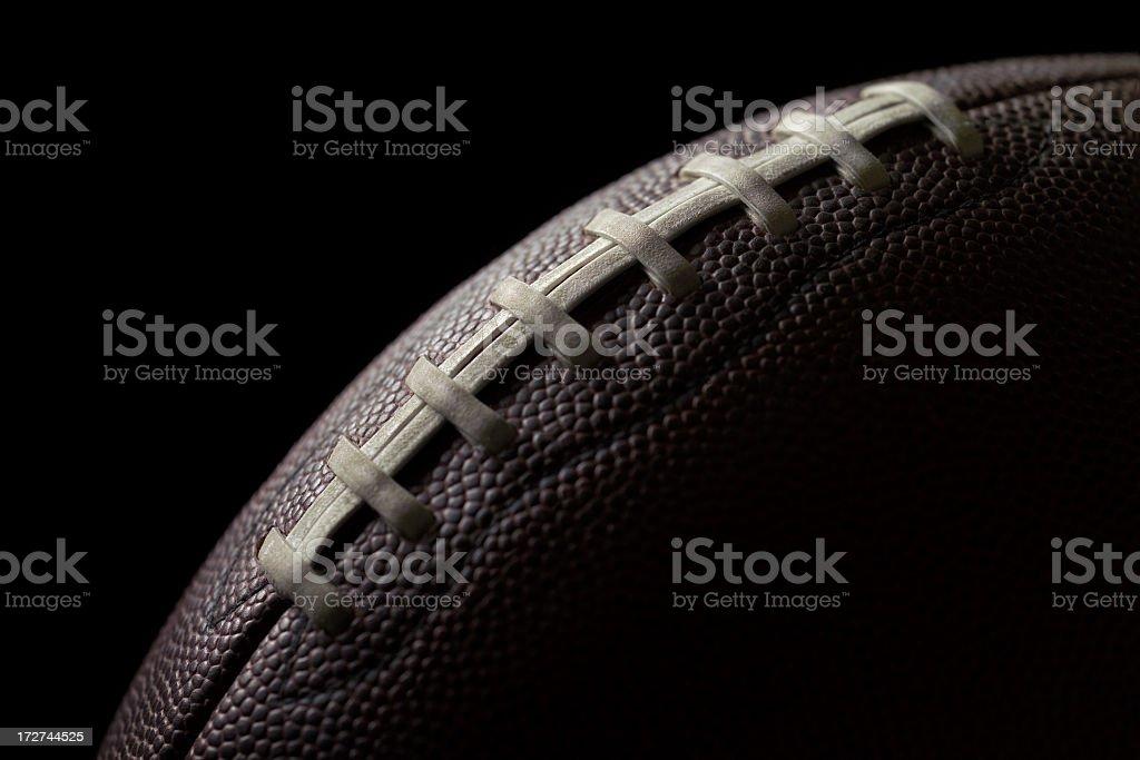 Black football on a black background royalty-free stock photo