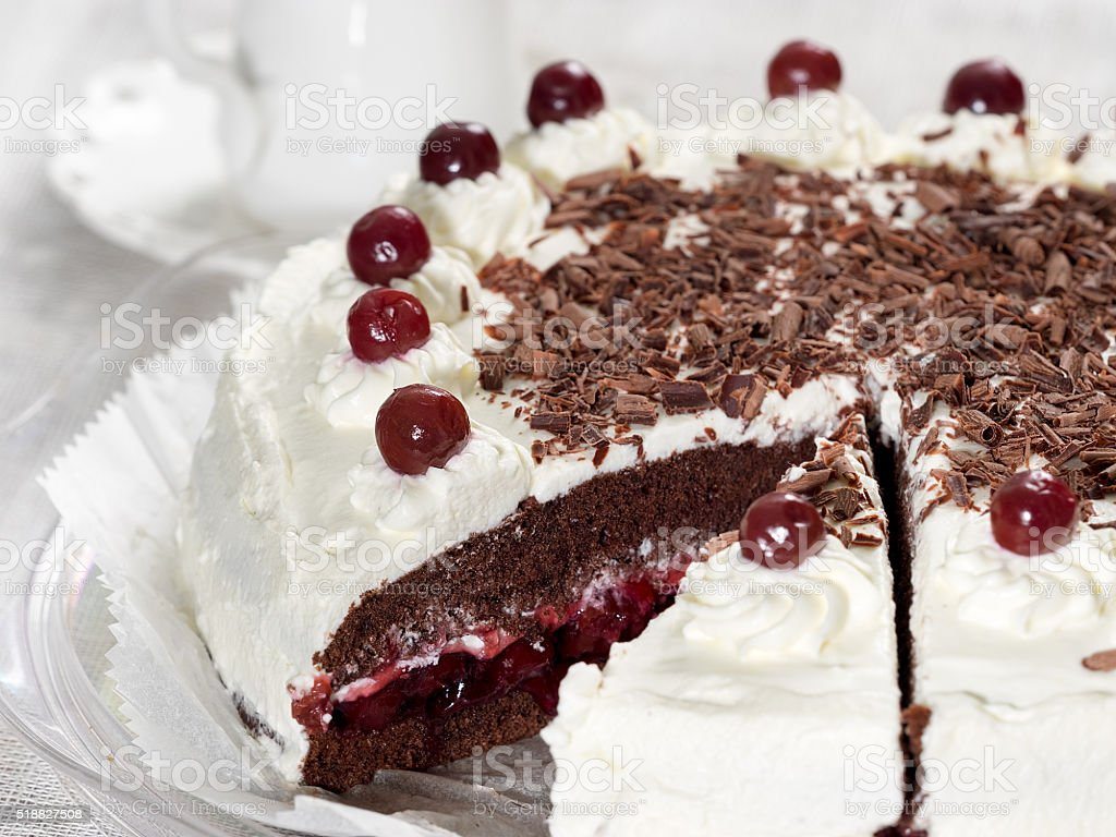 Black forest cake decorated with whipped cream and cherries royalty-free stock photo