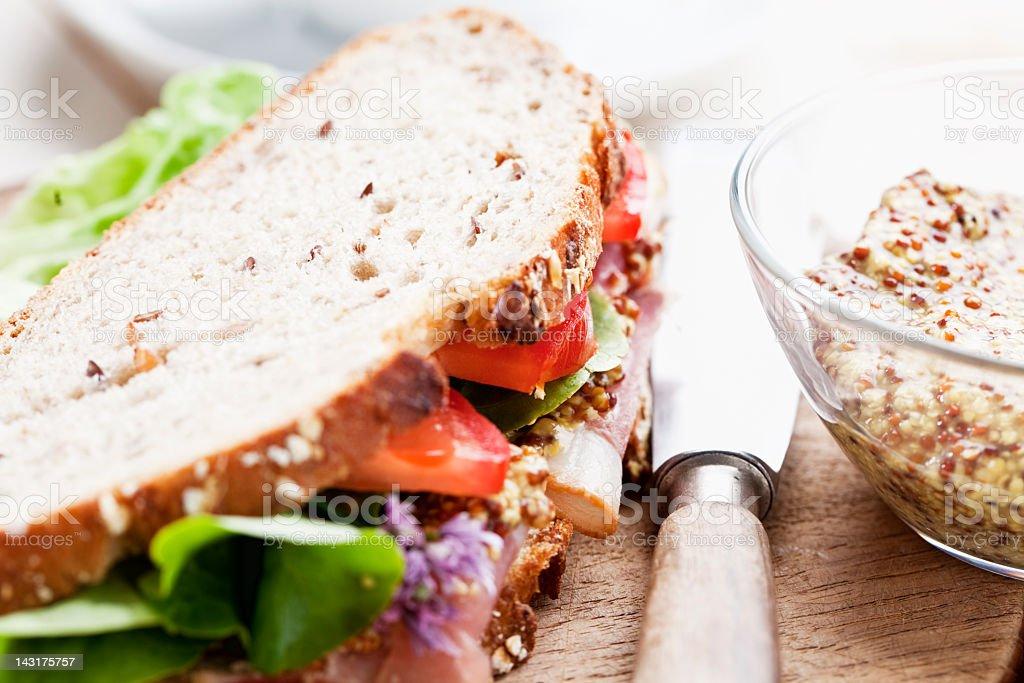 black forest ham whole grain bread tomato salad stock photo