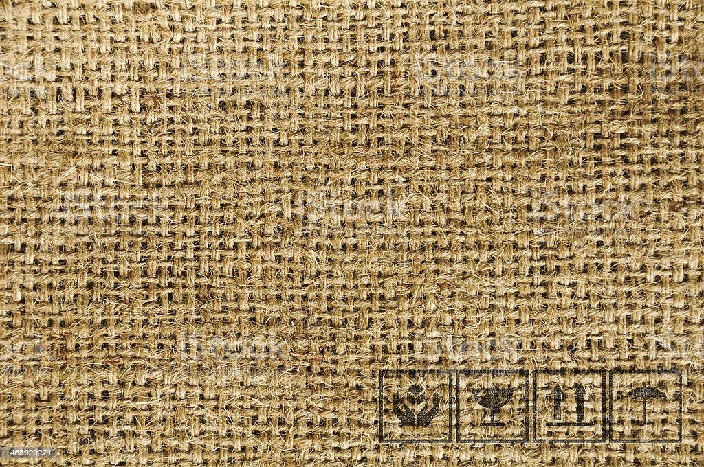 Black fragile symbol on sackcloth textured background royalty-free stock photo