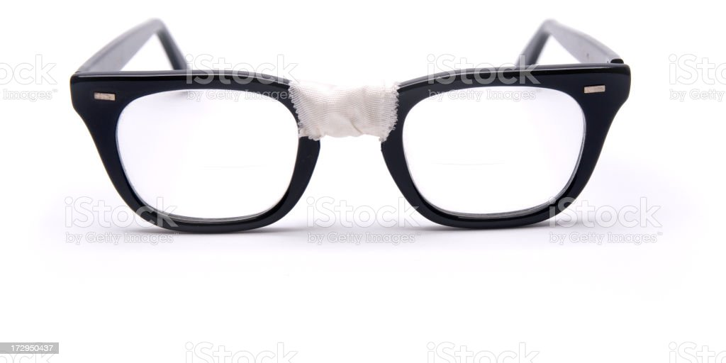Black framed glasses taped up in the middle stock photo