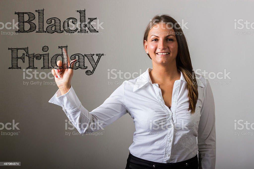 Black Friday - Beautiful girl touching transparent surface stock photo