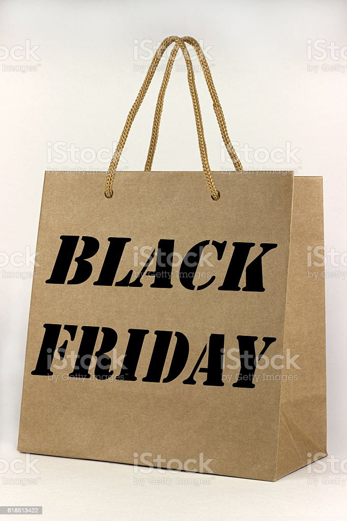 Black friday brown paper shopping bag on white stock photo
