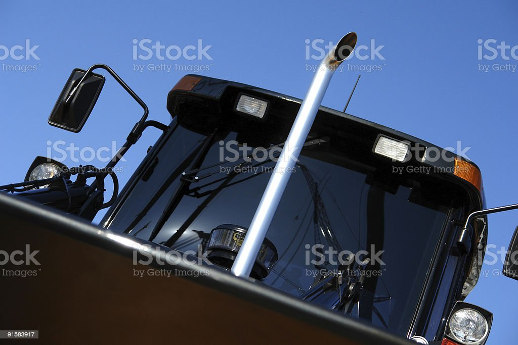 Black front loader clearing the area with clipping-path. stock photo