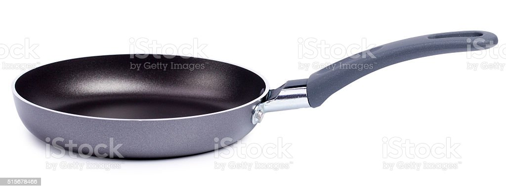 Black frying pan isolated on white background stock photo
