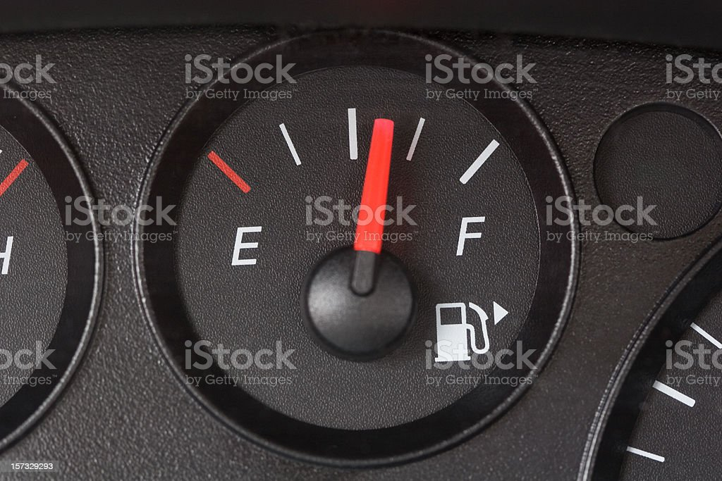 Black Fuel Gauge with Red Marker Over Half Full stock photo